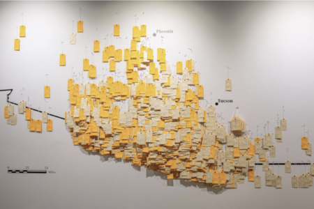 Wall map depicting toe tags of migrants where remains were found
